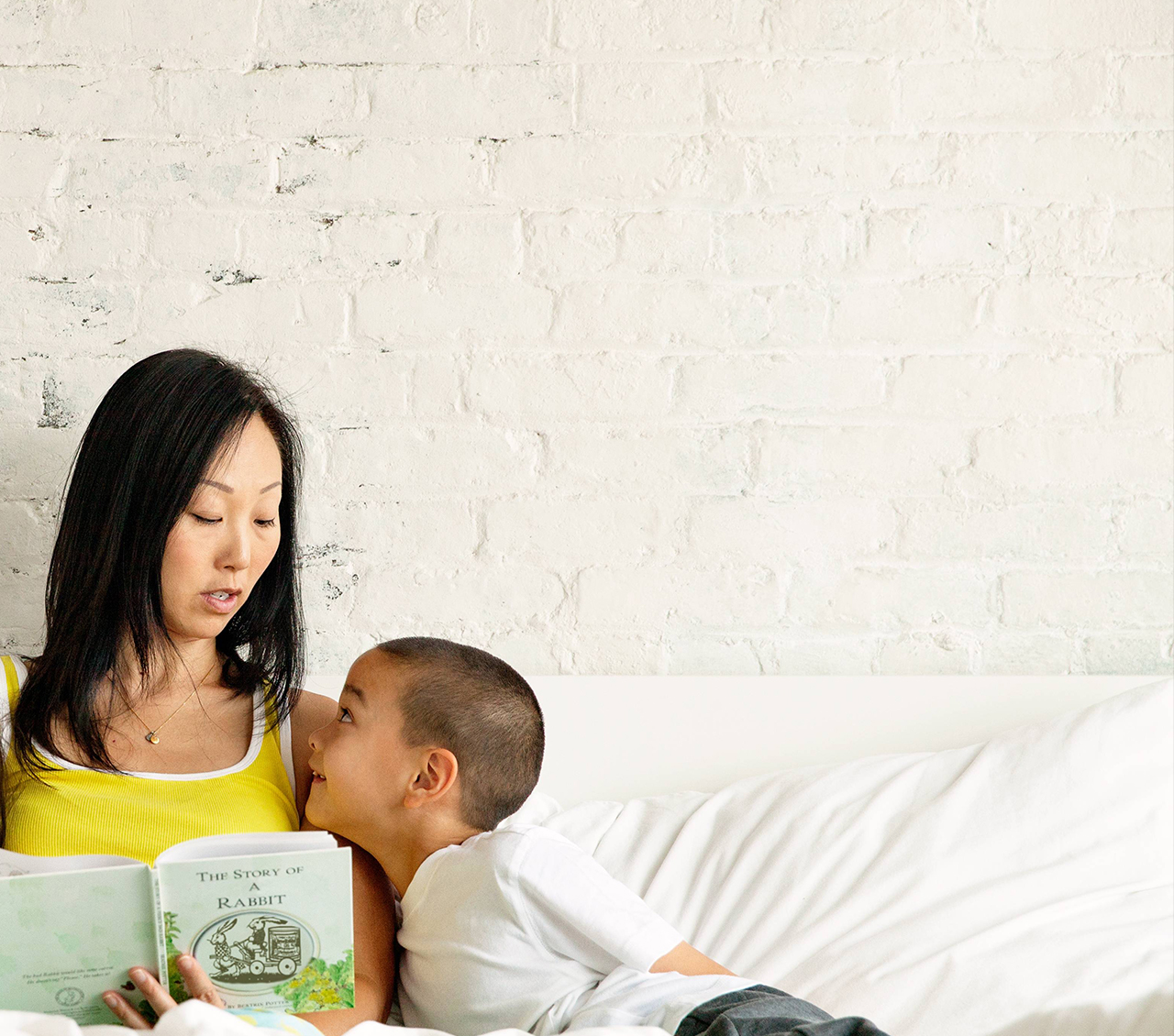a woman reads to her child